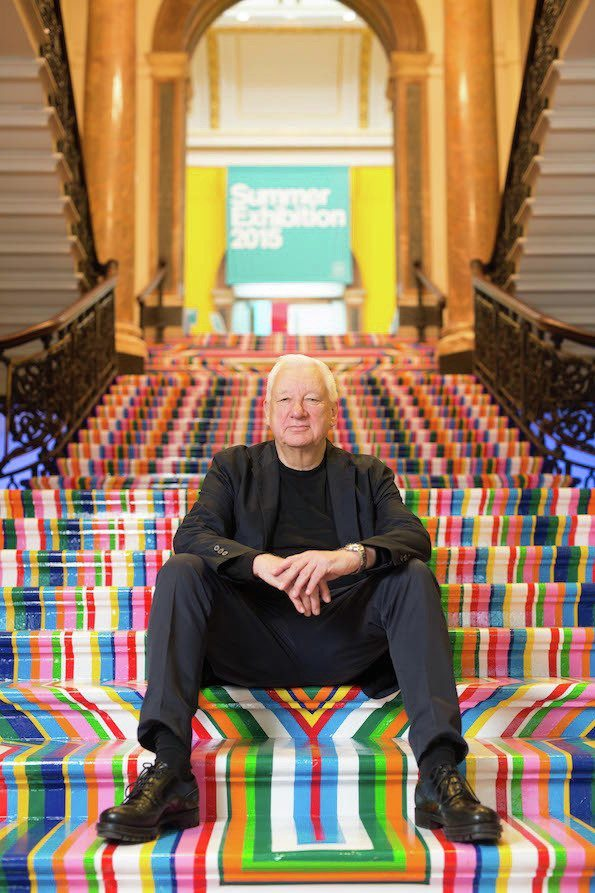 The Curator sits proudly against a backdrop of Jim Lambie's Kaleidoscopic stairset...