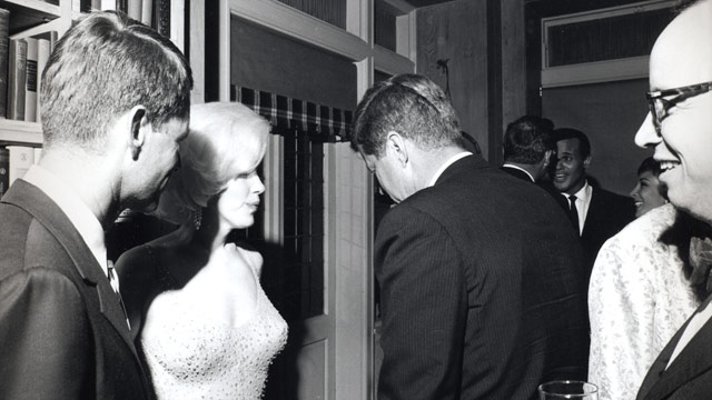 Marilyn Monroe speaks to US President John F. Kennedy.