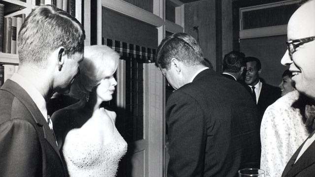 Marilyn Monroe speaks to US President John F. Kennedy.